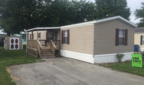 Lot #64 Mobile Home Villa   1999 Bluegrass 16×70 3 bedroom, 2 bath, brand new paint, brand new carpet, covered deck, mini-barn, central air, appliances included, total electric $24,900 with $2,000 down $340/month @ 12% for approx. 113 months