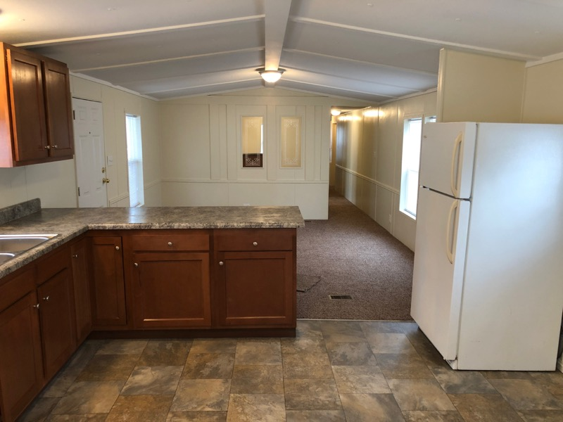 ... Counter Tops, New Paint Inside And Out, New Carpet, New Vinyl Flooring,  New Skirting, Metal Siding, Rubber Roof, Central Air, Large Covered Deck,  ...